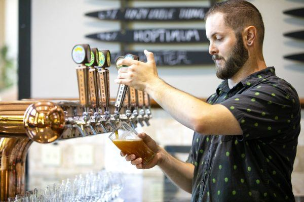 Pouring beer in the tasting room