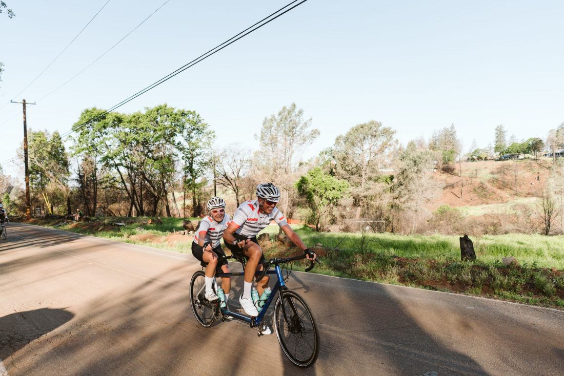 Tandem cyclists climbing Honey Run Road during the Chico Wildflower