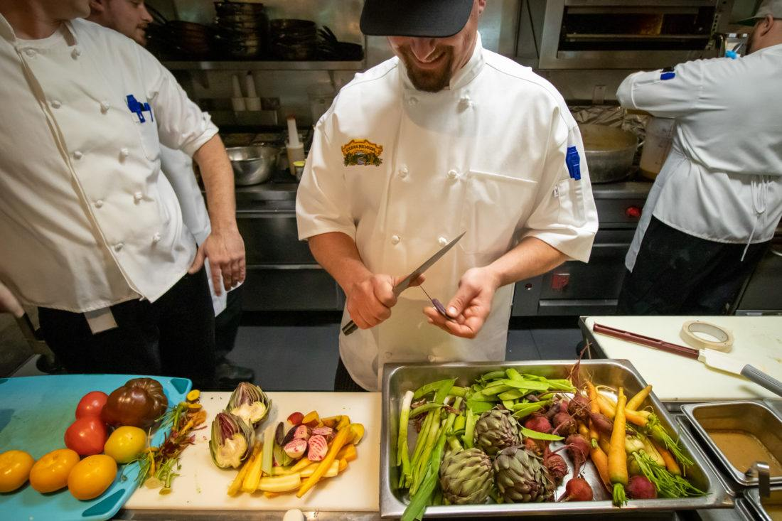Sierra Nevada Brewing Company chef cutting vegetables in kitchen