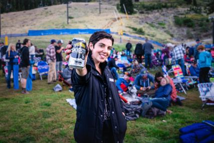 Woman holdling can of Skiesta beer at festival