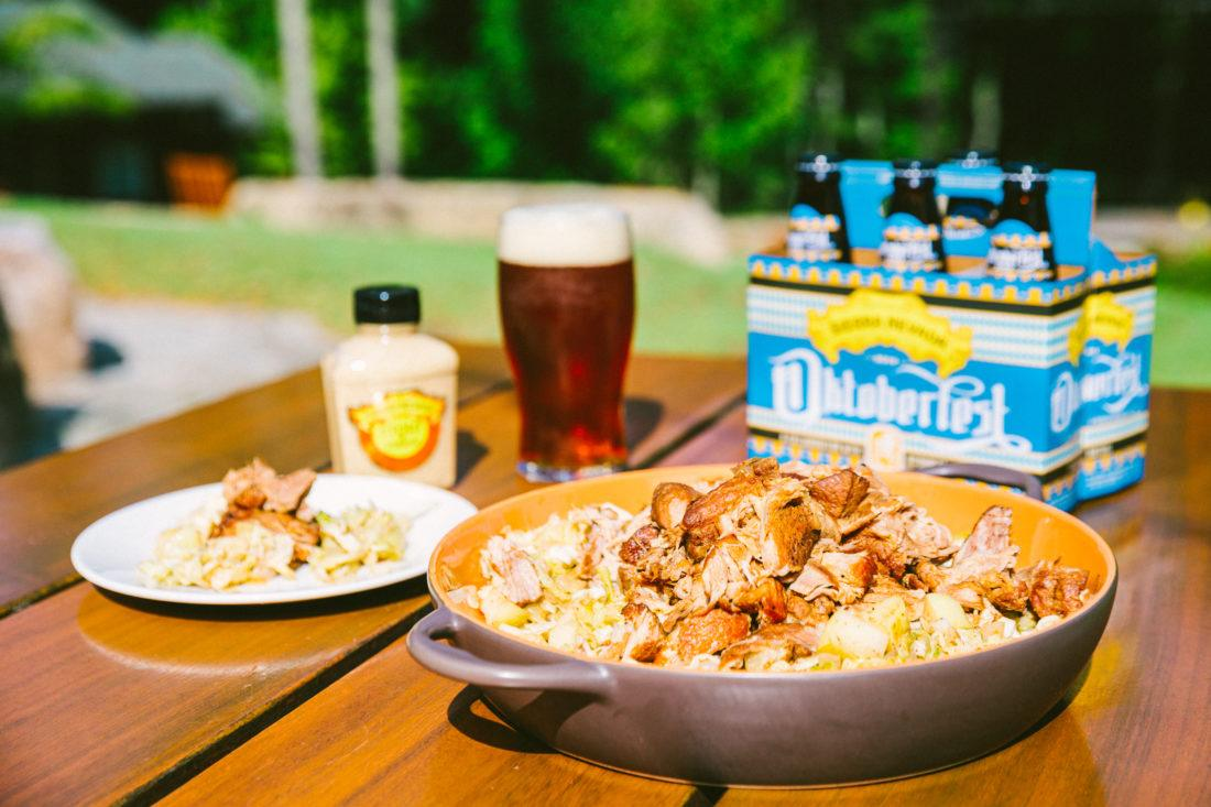 braised pork and Oktoberfest beer on a picnic table