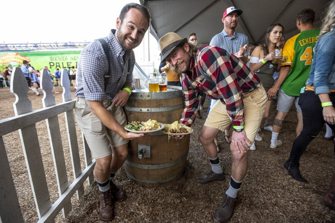 Group of people at Oktoberfest with plates of barrel-aged sauerkraut