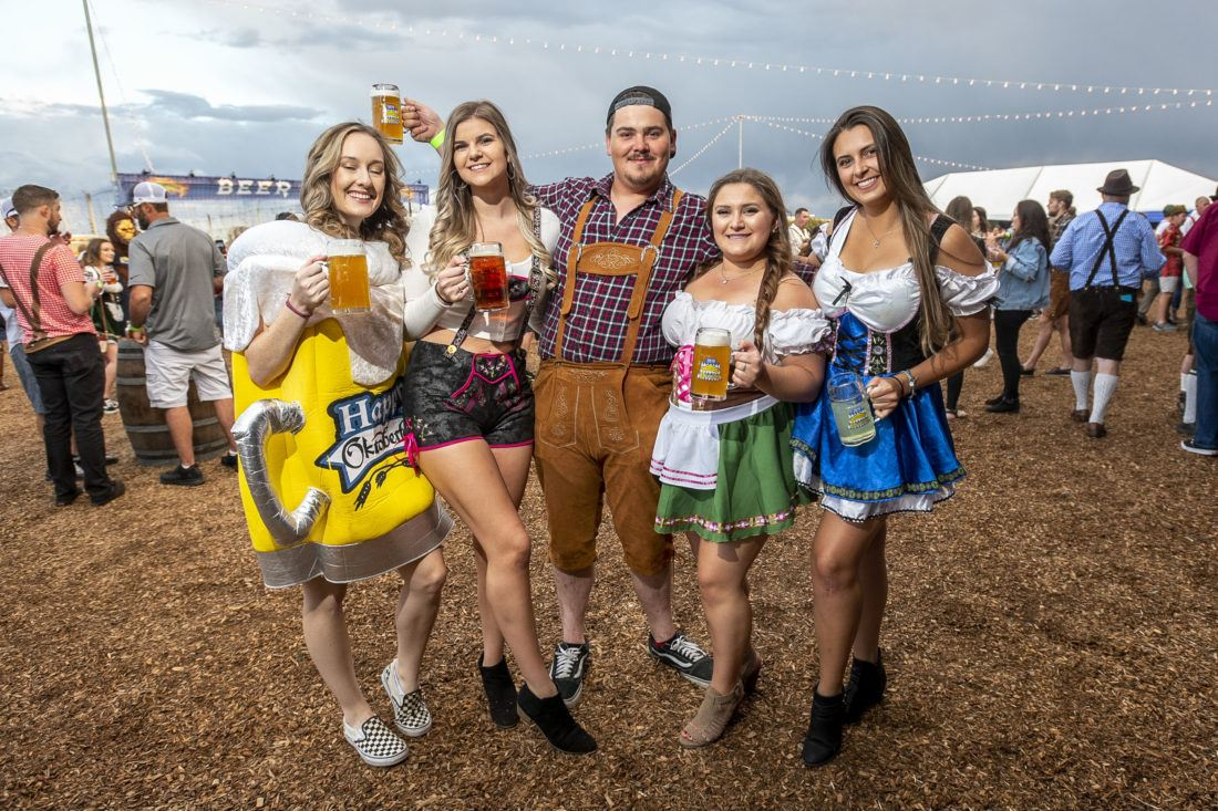 Group of people holding beers at Sierra Nevada Brewing Company's Oktoberfest party
