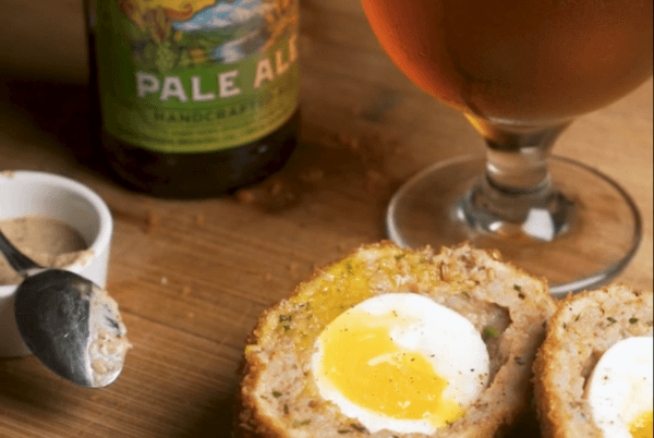 Scotch egg cut in half next to Sierra Nevada Pale Ale