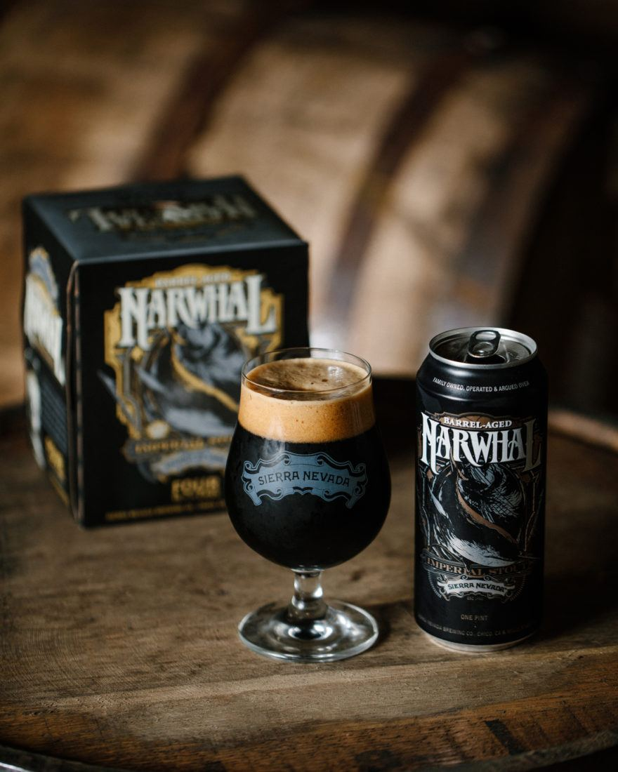Sierra Nevada Barrel Aged Narwhal beer staged on top of a wooden barrel