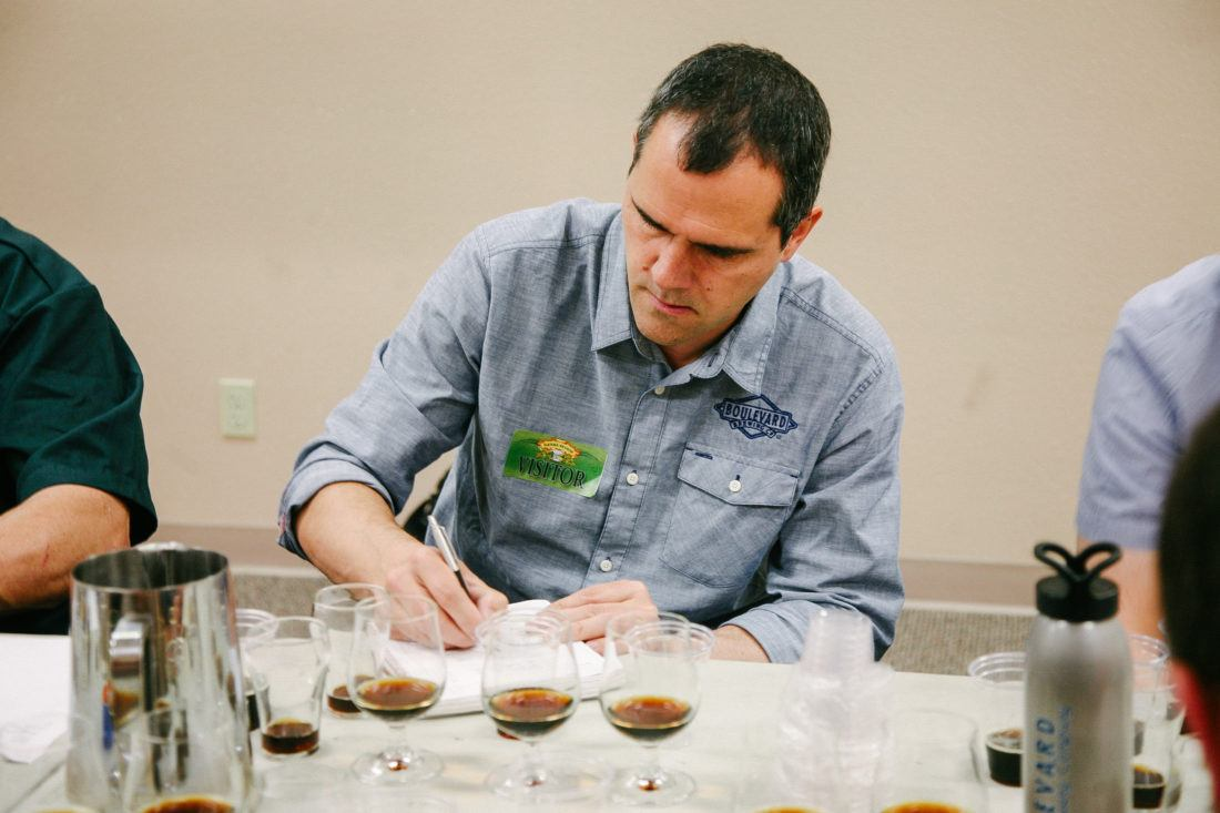 Boulevard Brewing's Steven Pauwels taking notes during a beer-blending session for Terra Incognita