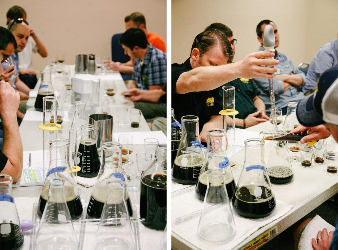Brewers around a table blending beer using droppers and beakers