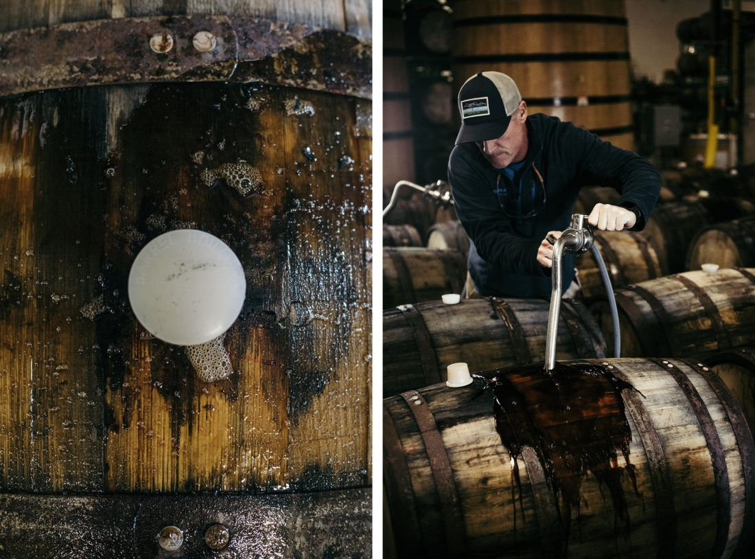 Brewer filling bourbon barrels with beer