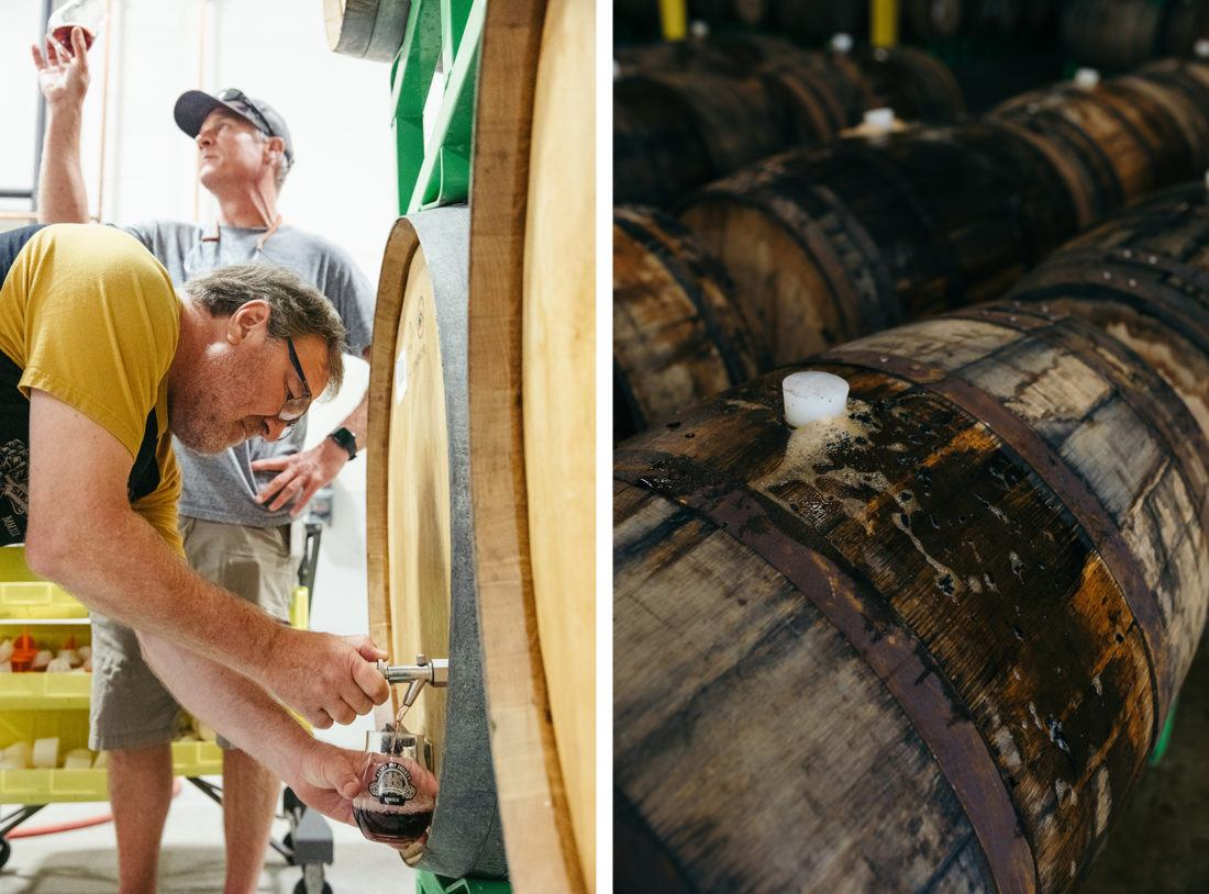 Two brewers pour barrel aged beer samples from wooden casks at Sierra Nevada Brewing Company