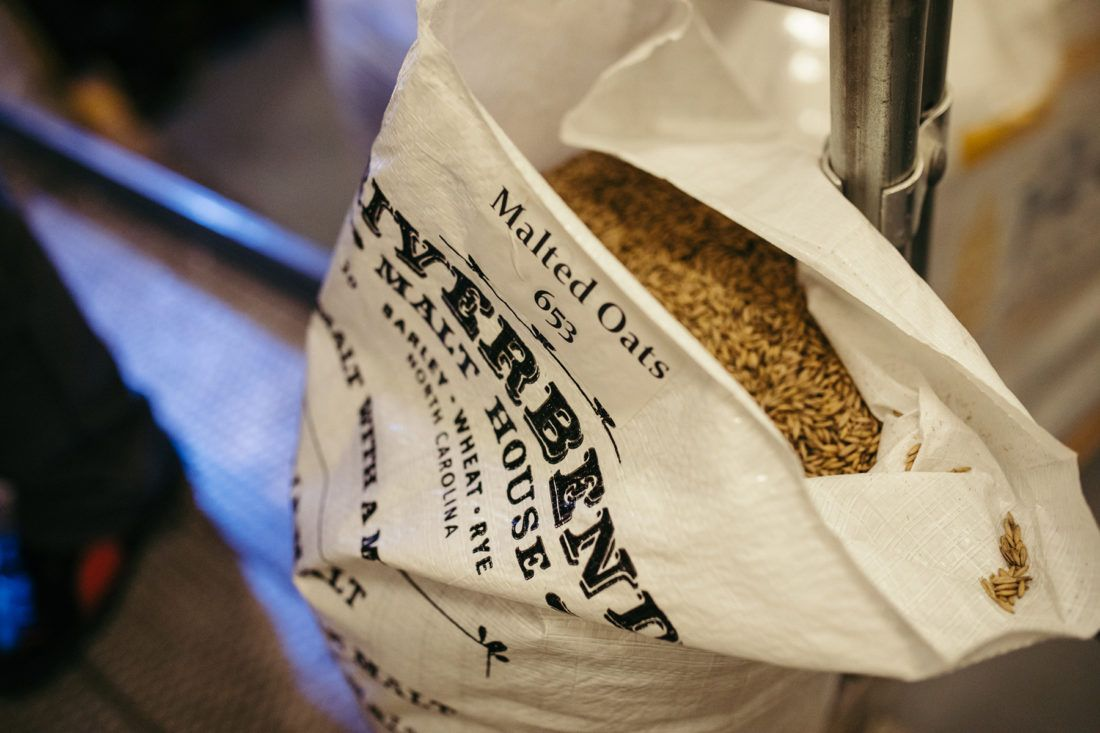 An open bag of malted oats from Riverbend Malt House