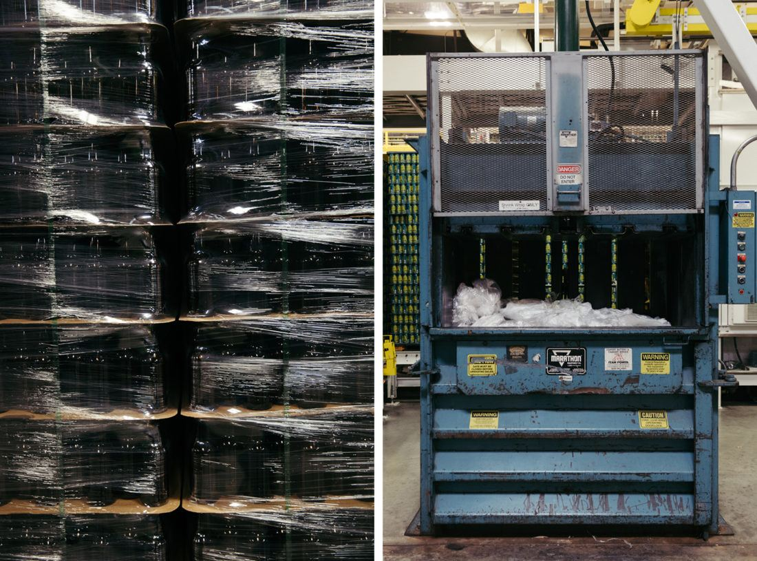 A stack of brown bottles covered with shrink wrap, and a baler machine designed for shrink wrap