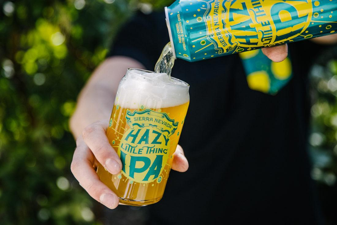Pouring a can of Sierra Nevada Hazy Little Thing IPA into a custom Hazy Little Thing glass.