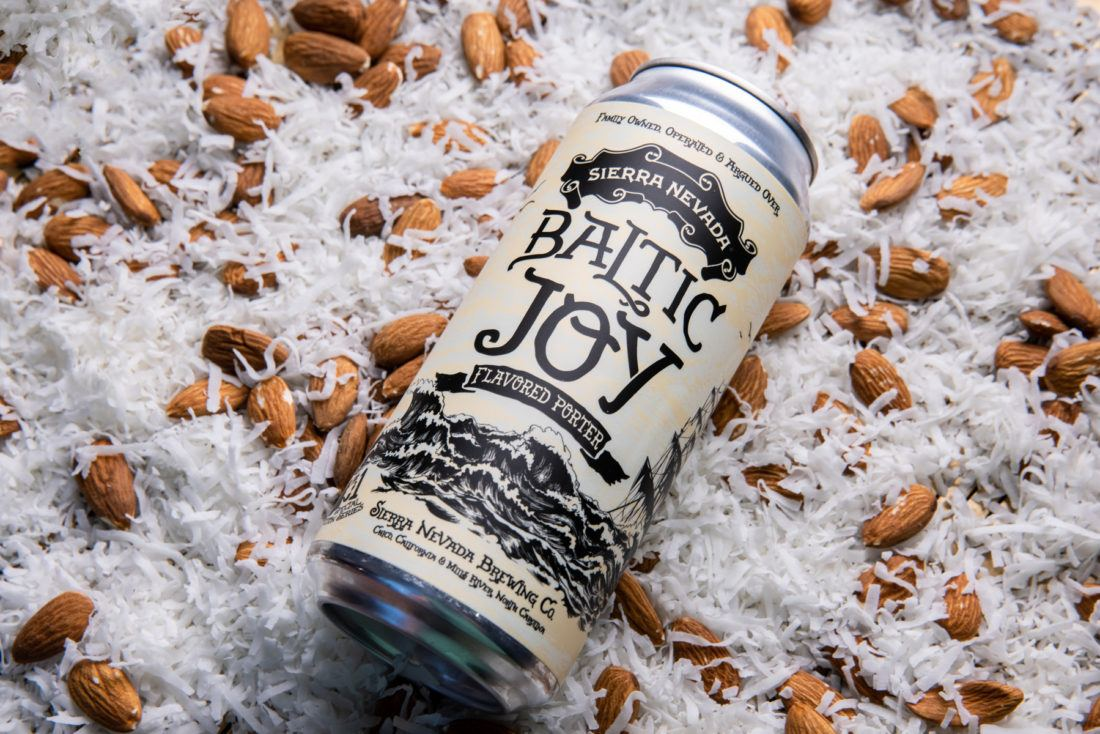 A can of Baltic Joy Porter resting on a bed of almonds and coconut