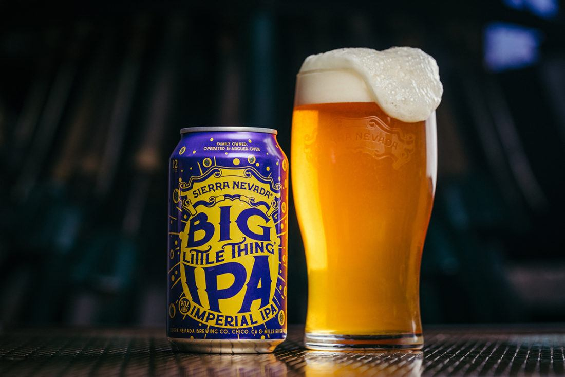 A can and full pint glass of Big Little Thing Imperial IPA