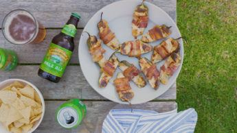 Overhead view of a picnic table with a plate of Sierra Nevada Pale Ale jalapeno poppers