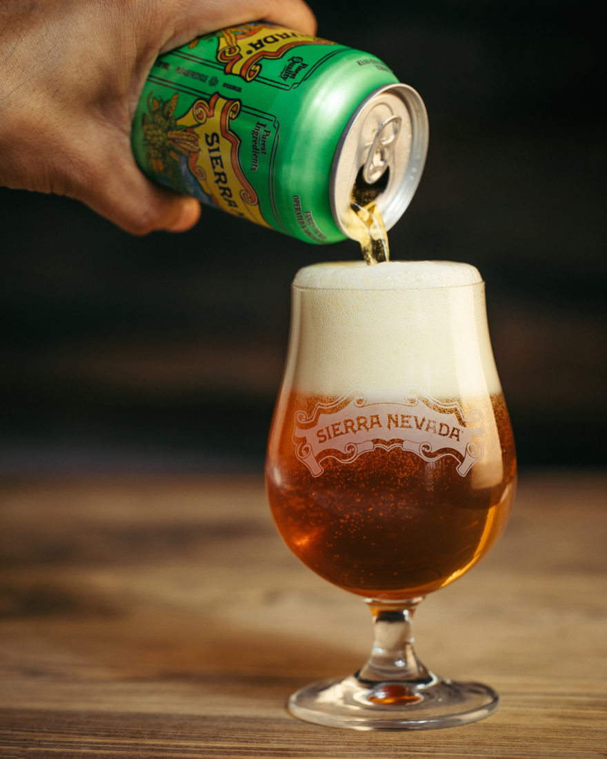 Pouring a can of Sierra Nevada Pale Ale into a glass